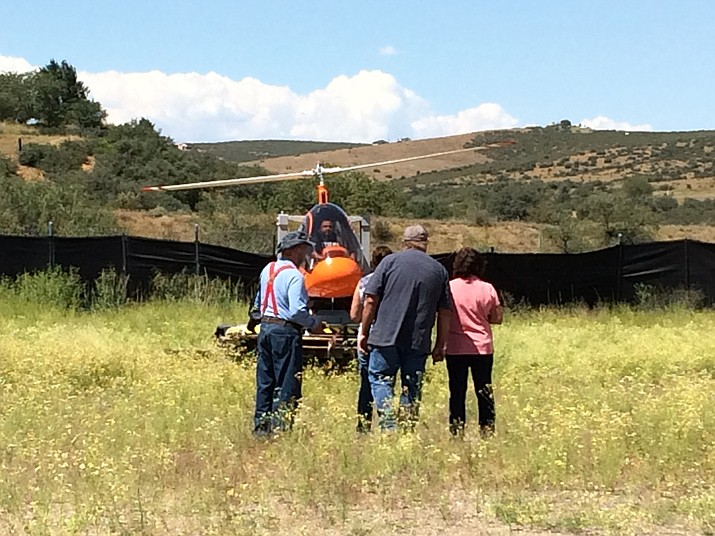 """Luis Pena """"flies"""" the Cicare SVH4 helicopter trainer as others take readings from decibel readers to find out how much noise it produces. Pena has applied for a use permit to establish a helicopter training school in Dewey. (Sue Tone/Tribune)"""