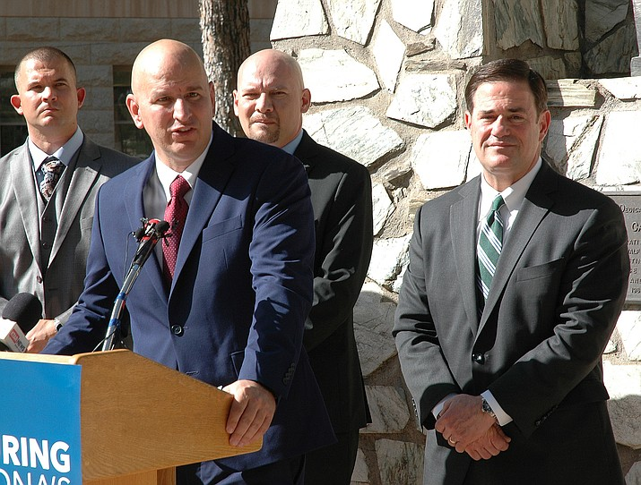 Brandon Judd, president of the National Border Patrol Council, explains Monday why his group supports Gov. Doug Ducey, looking on, in his bid for reelection. (Howard Fischer, Capitol Media Services/Courtesy)