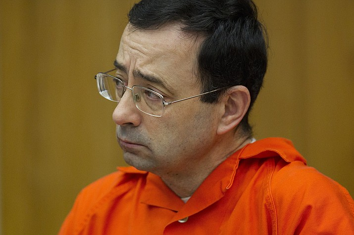 In this Jan. 31, 2018, file photo, Larry Nassar appears for his sentencing at Eaton County Circuit Court in Charlotte, Mich. Lawyers rushed to meet a Monday, Sept. 10, deadline to file lawsuits against Michigan State University to qualify for $75 million set aside for more victims of Nassar. (Cory Morse/The Grand Rapids Press via AP, file)