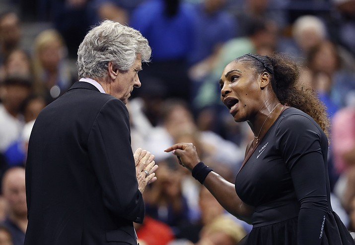 In this Saturday, Sept. 8, 2018, file photo, Serena Williams, right, talks with referee Brian Earley during the women's final of the U.S. Open tennis tournament against Naomi Osaka, of Japan, in New York. (Adam Hunger/AP, file)