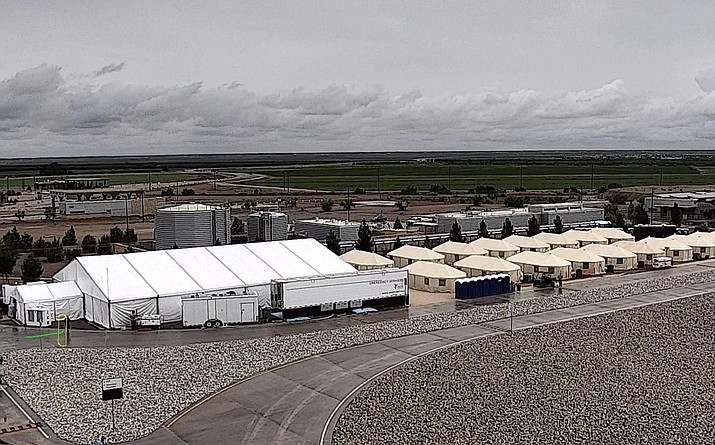HHS' Administration for Children and Families shelter is used to house unaccompanied foreign children in Tornillo, Texas. The U.S. government says the West Texas tent shelter will remain open through the end of the year. A spokesman for the U.S. Department of Health and Human Services said Tuesday, Sept. 11, 2018, that the facility will be expanded to 3,800 beds from its initial capacity of 360 beds. (HHS' Administration for Children and Families via AP, File)