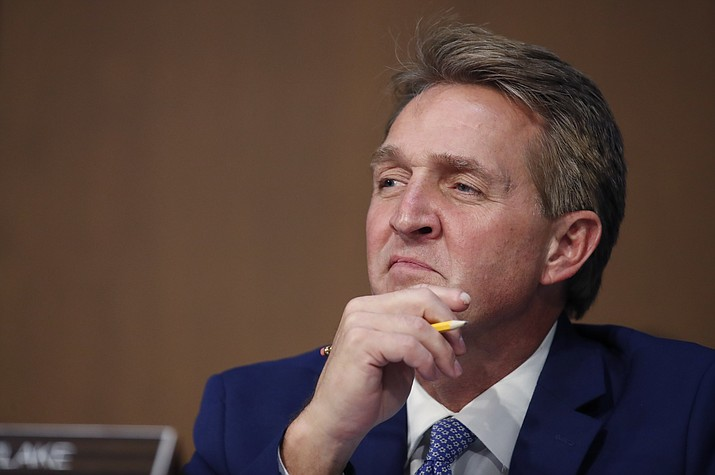 Sen. Jeff Flake, R-Ariz., listens as President Donald Trump's Supreme Court nominee, Brett Kavanaugh testifies before the Senate Judiciary Committee on Capitol Hill in Washington, Thursday, Sept. 6, 2018, for the third day of his confirmation hearing to replace retired Justice Anthony Kennedy. (Alex Brandon/AP Photo)