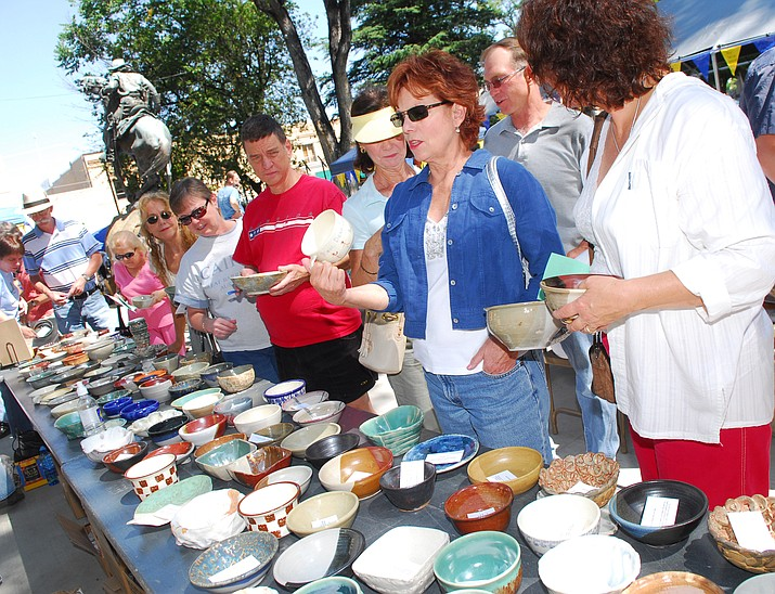 Patrons look for their favorite bowl for soup and a good cause at the Empty Bowls event Sept. 14, 2008, on the Yavapai County Courthouse Plaza. (Les Stukenberg/Courier file)