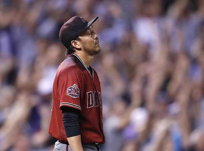 Arizona Diamondbacks relief pitcher Yoshihisa Hirano reacts after giving up a two-run, walkoff home run to Colorado Rockies' DJ LeMahieu in the ninth inning of a baseball game Wednesday, Sept. 12, 2018, in Denver. The Rockies won 5-4. (David Zalubowski/AP)
