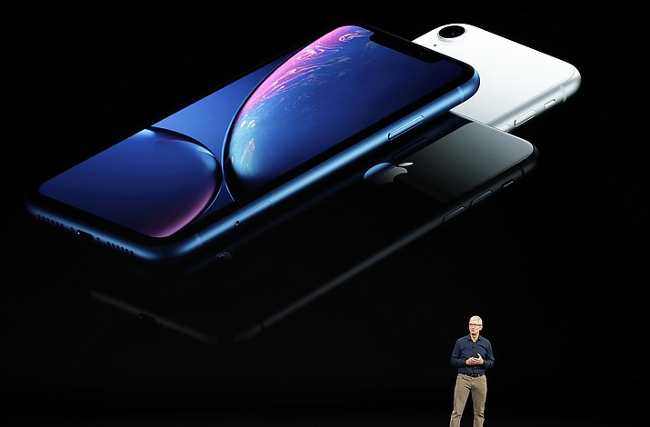 Apple CEO Tim Cook discusses the new iPhones at the Steve Jobs Theater during an event to announce new products Wednesday, Sept. 12, 2018, in Cupertino, Calif. (Marcio Jose Sanchez/AP Phone)