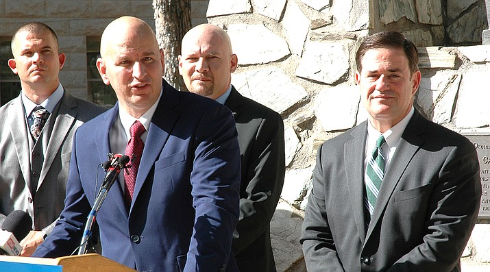 Brandon Judd, president of the National Border Patrol Council, explains Monday why his group supports the bid of Gov. Doug Ducey, looking on, in his bid for reelection. (Capitol Media Services photo by Howard Fischer)