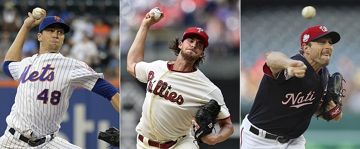 FILE - From left are 2018 file photos showing New York Mets pitcher Jacob deGrom,  Philadelphia Phillies pitcher Aaron Nola and Washington Nationals pitcher Max Scherzer. Jacob deGrom, Max Scherzer and Aaron Nola are going pitch for pitch in the NL Cy Young Award race. Baseball's advanced analytics think an MVP might be on the line between that trio, too. (AP Photos, file)