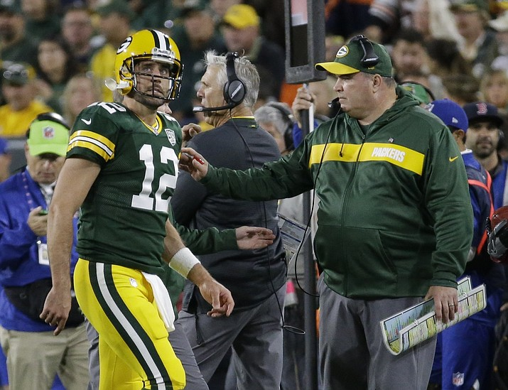 Green Bay Packers head coach Mike McCarthy looks at Aaron Rodgers as he walks off the field after injuring his leg during the first half of an NFL football game against the Chicago Bears Sunday, Sept. 9, 2018, in Green Bay, Wis. (Mike Roemer/AP)