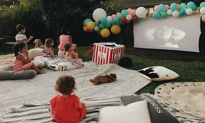 "Children take in the movie ""Shrek"" on an outdoor theater setup in Concord, Calif., for a backyard birthday party. (Rozalyn Schlumpf/Wittybash.com via AP)"