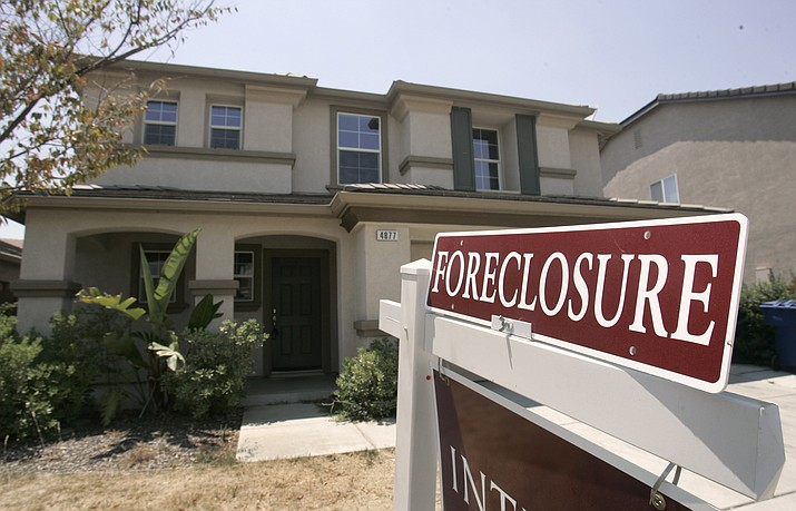 Foreclosed homes were largely the result of borrowers getting in over their heads. As home values plummeted after the housing bubble burst in 2007, many borrowers with exotic types of loans were stuck, unable to refinance as lenders began to tighten their lending criteria. That set the stage for cascading mortgage defaults. (Rich Pedroncelli/AP, File)