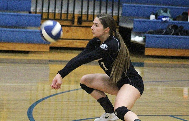 Kingman Academy's Isabella Anderson tallied nine kills in a sweep of Kingman High. (Photo by Beau Bearden/Daily Miner)