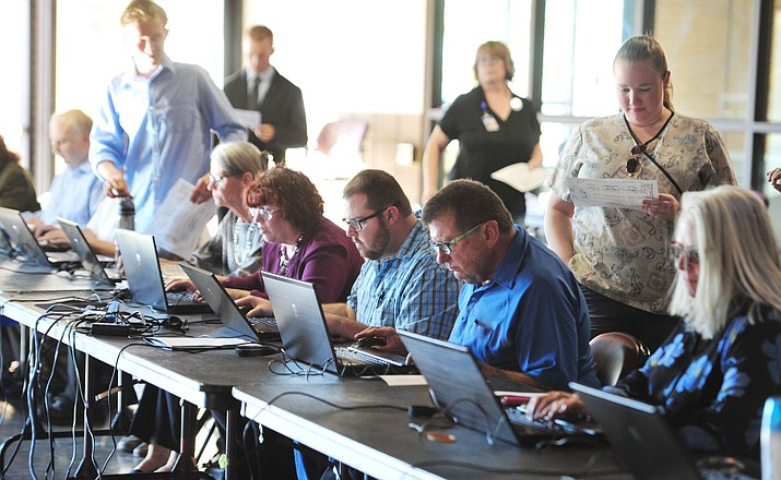 Job seekers register to attend the job fair hosted by the Prescott Valley Chamber of Commerce Wednesday Sept. 12, 2018 at the Prescott Valley Event Center. (Les Stukenberg/Courier)