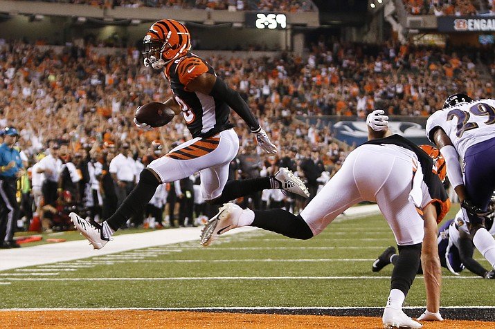 Cincinnati Bengals wide receiver Tyler Boyd (83) leaps in for a touchdown in the first half of an NFL football game against the Baltimore Ravens, Thursday, Sept. 13, 2018, in Cincinnati. (Frank Victores/AP)