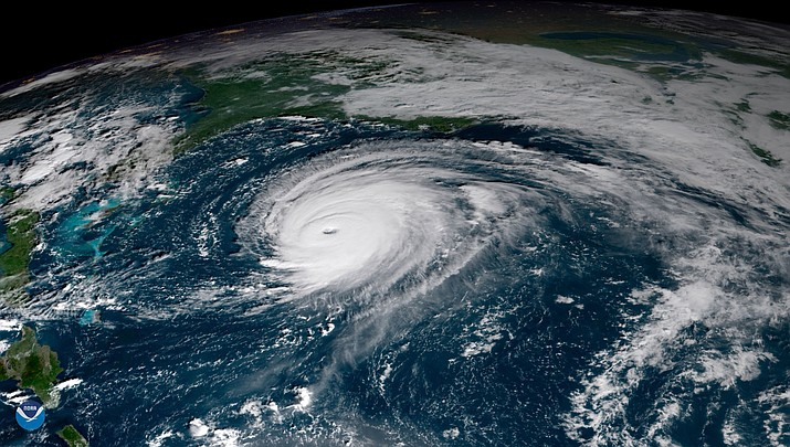Hurricane Florence looks enormous, even from space. Here is dramatic view of the storm approaching the East Coast, seen from the GOES East satellite on the morning of Wednesday, Sept. 12.   (NOAA photo)