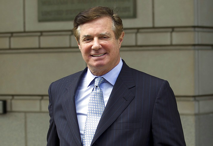 In this May 23, 2018, file photo, Paul Manafort, President Donald Trump's former campaign chairman, leaves the Federal District Court after a hearing, in Washington. A federal judge in Washington has denied Paul Manafort's request to move his second trial from the District of Columbia. U.S. District Judge Amy Berman Jackson says Manafort hasn't shown that he couldn't pick an impartial jury in the District of Columbia due to pre-trail publicity. (AP Photo/Jose Luis Magana, File)