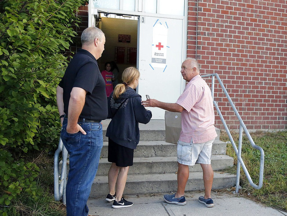 Michael Smolak, of Smolak Farms in North Andover, delivers a bag of baked goods to the emergency shelter set up at North Andover High School of Friday, Sept 14, 2018.  Many residents were forced to evacuate their homes Thursday afternoon after gas explosions and fires triggered by a problem with a gas line that feeds homes in several communities north of Boston (AP Photo/Mary Schwalm)