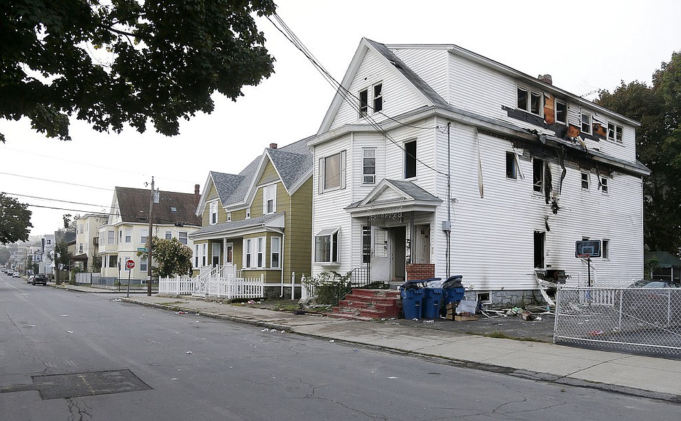 A damaged house on Bowdoin Street in Lawrence Mass., is seen Friday, Sept. 14, 2018. The home was one of multiple houses that went up in flames on Thursday afternoon after gas explosions and fires triggered by a problem with a gas line that feeds homes in several communities north of Boston (AP Photo/Mary Schwalm)