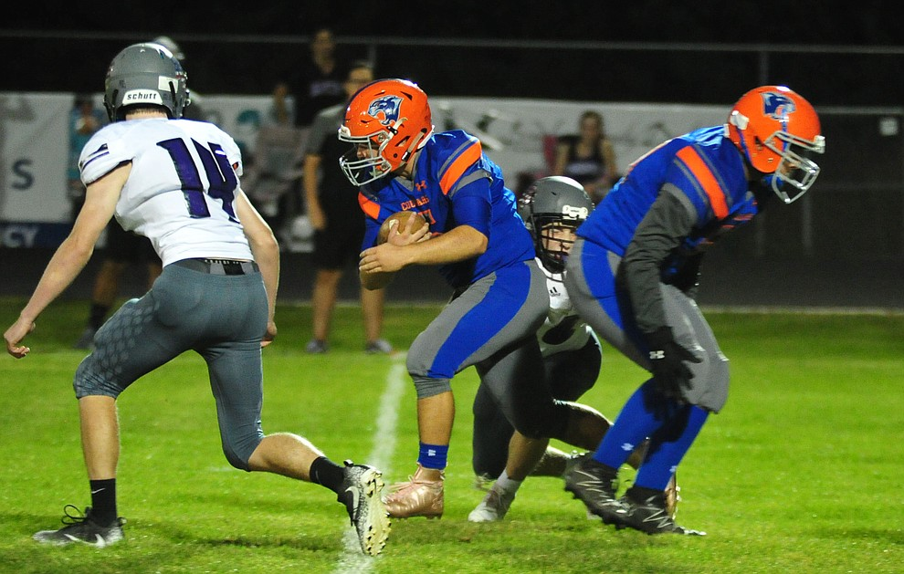 Chino Valley's Mikey Paulus breaks a long run in the first quarter as the Cougars host Arizona College Prep Friday, Sept. 14, 2018. (Les Stukenberg/Courier)