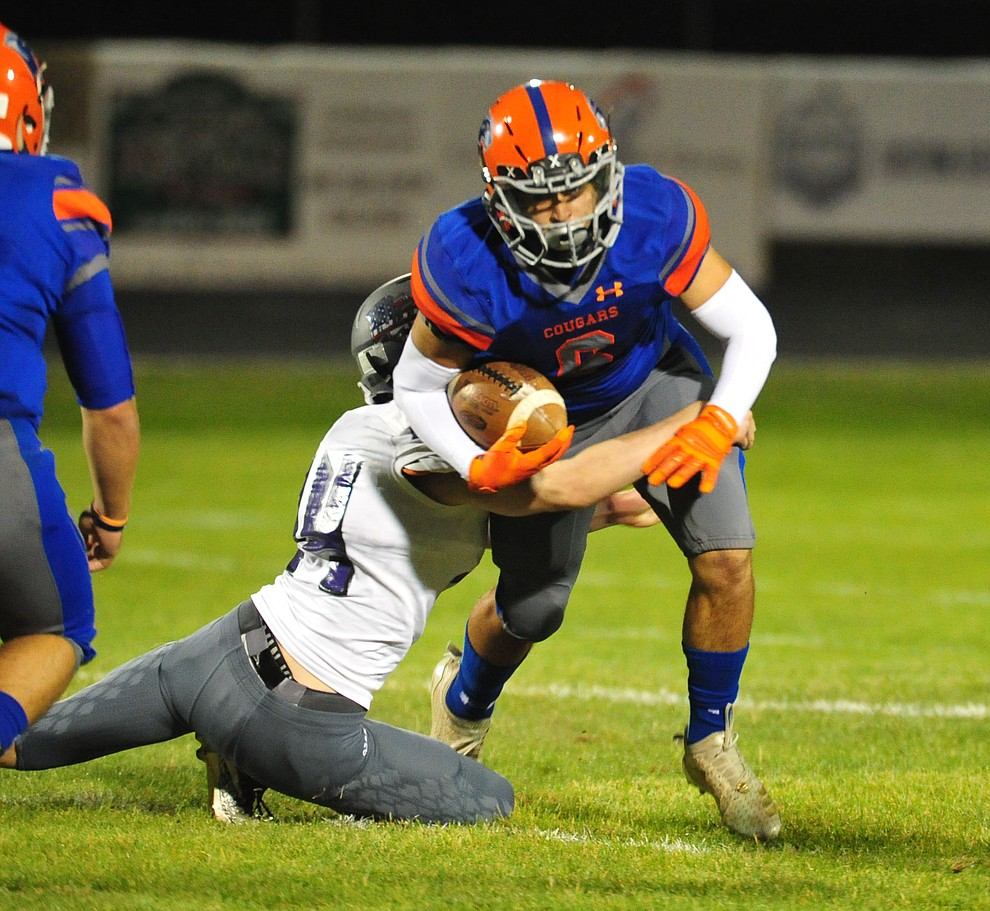 Chino Valley's Elijah Scordato tries for more yardage as the Cougars host Arizona College Prep Friday, Sept. 14, 2018. (Les Stukenberg/Courier)