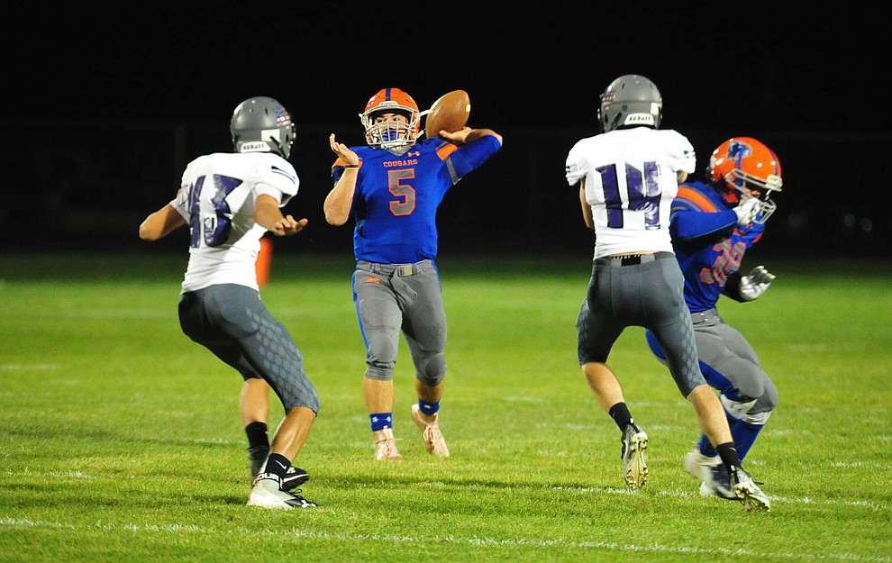 Chino Valley's Mikey Paulus delivers a touchdown pass as the Cougars host Arizona College Prep Friday, Sept. 14, 2018. (Les Stukenberg/Courier)