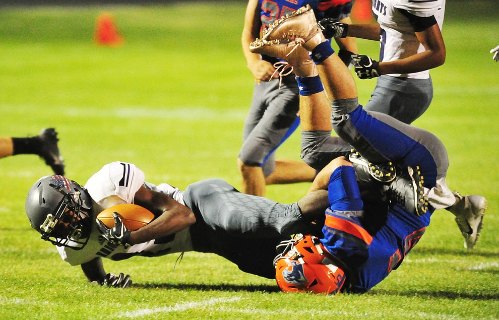 Chino Valley's Mikey Paulus makes a tackle as the Cougars host Arizona College Prep Friday, Sept. 14, 2018. (Les Stukenberg/Courier)