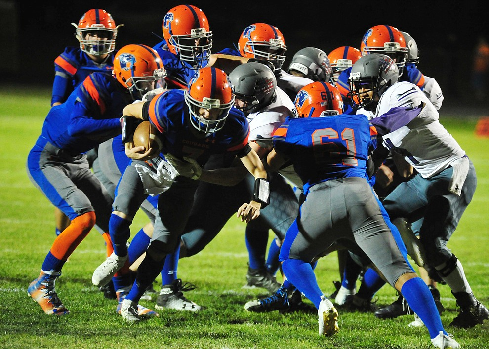 Chino Valley's Tyler Carey has a convoy of blockers as the Cougars host Arizona College Prep Friday, Sept. 14, 2018. (Les Stukenberg/Courier)
