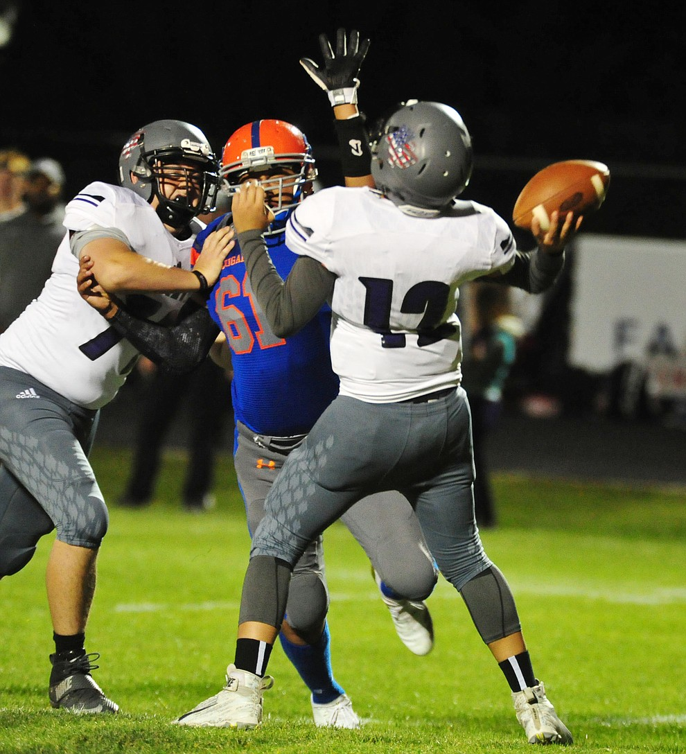 Chino Valley's Rudy Melendez puts pressure on the quarterback as the Cougars host Arizona College Prep Friday, Sept. 14, 2018. (Les Stukenberg/Courier)