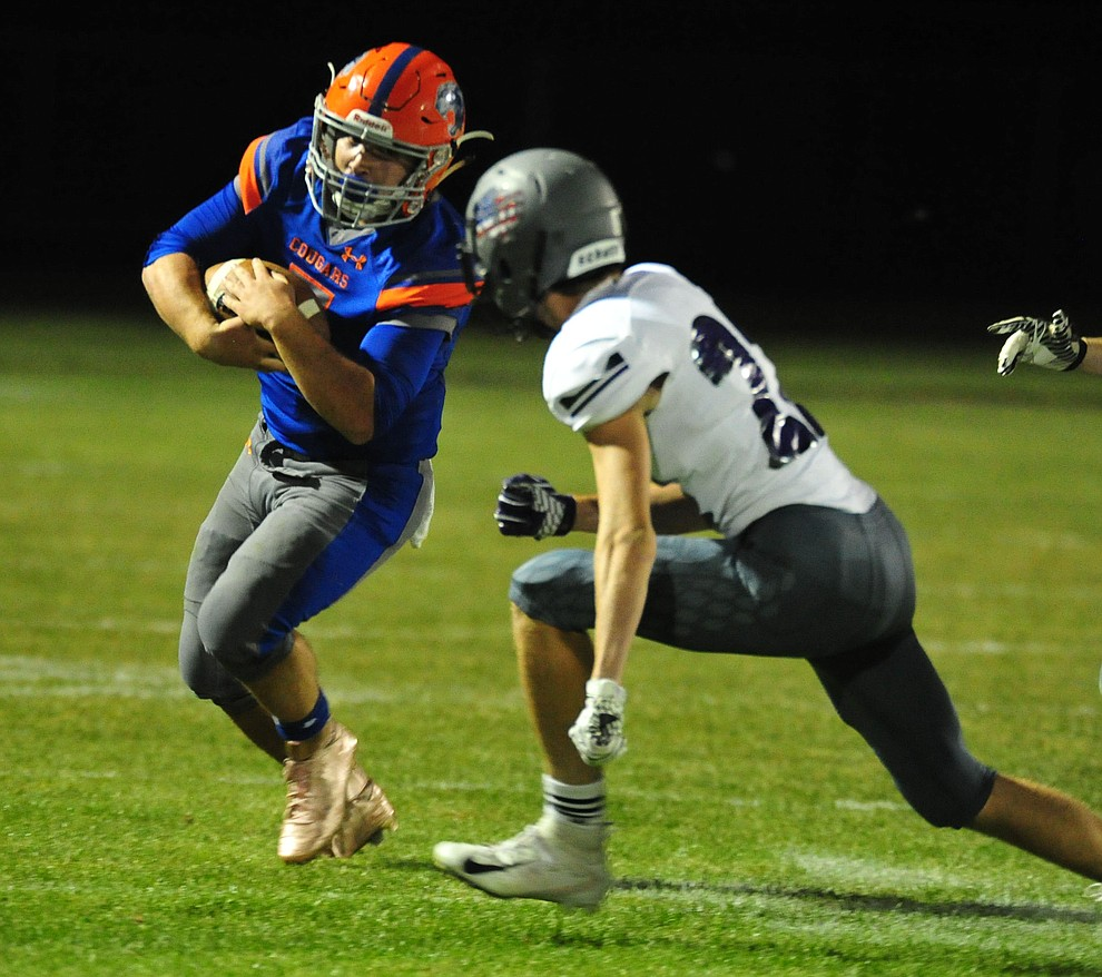 Chino Valley's Mikey Paulus gets a big gain to end the first half as the Cougars host Arizona College Prep Friday, Sept. 14, 2018. (Les Stukenberg/Courier)