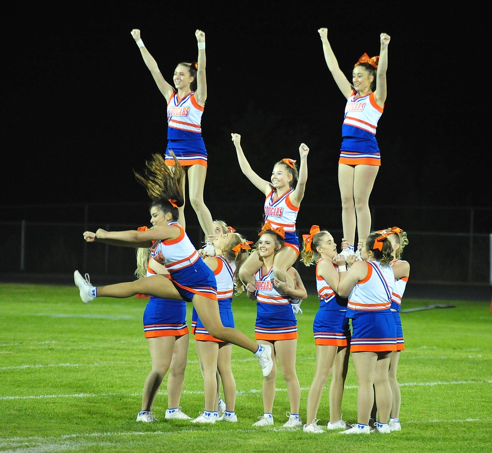 Chino Valley's cheereaders perform at halftime as the Cougars host Arizona College Prep Friday, Sept. 14, 2018. (Les Stukenberg/Courier)