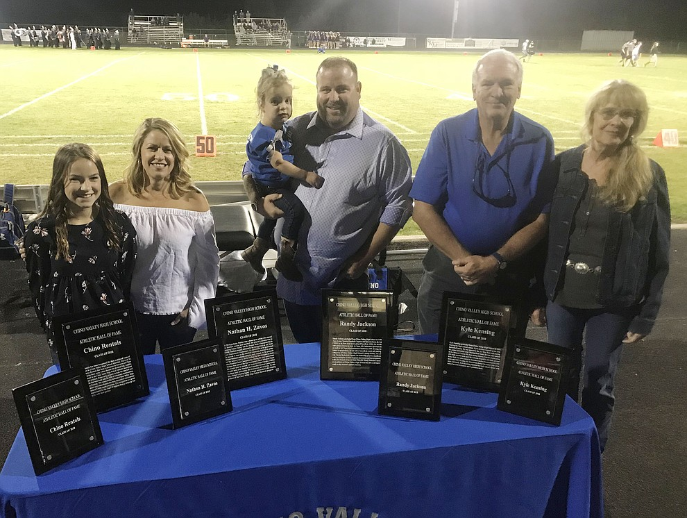 Marley and Cheyenne Tenberge representing Chino Rentals, Randy Jackson, Gary and Karen Kensing represnting their son Kyle and not pictured  Nathan Zavos were inducted into the Chino Valley High School Hall of Fame Friday Sept. 14, 2018 at halftime of the home football against Arizona College Prep. (Les Stukenberg/Courier)