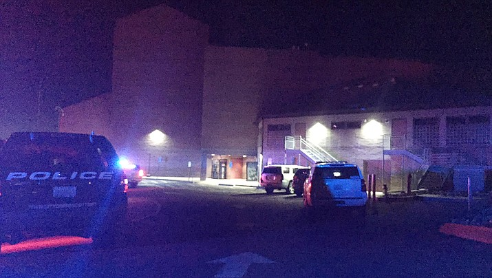 Prescott Police have Prescott High School surrounded, and appear to be working to clear the building Friday evening at about 7:30. (Max Efrein/Courier)