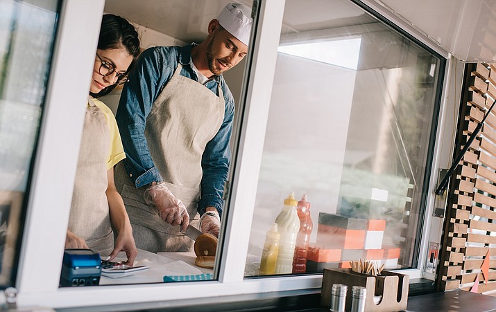 "Even an improving economy does not mean everyone in the state is doing better. ""More and more folks are working, but the wages are not yet keeping up with what is needed to support a family or an individual who is working full time,"" said Cynthia Zwick, executive director of the Arizona Community Action Association. (Stock photo)"