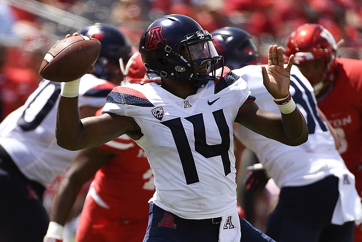 Arizona quarterback Khalil Tate (14) drops back to pass during the second half of an NCAA college football game against Houston, Saturday, Sept. 8, 2018, in Houston. (Eric Christian Smith/AP, file)