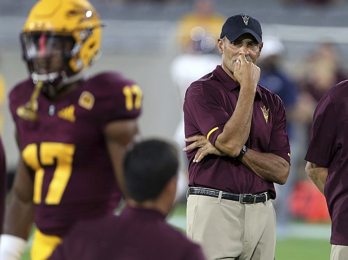 In this Sept. 1, 2018, file photo, Arizona State coach Herm Edwards watches his team warm up for an NCAA college football game against UTSA in Tempe, Ariz. Arizona State rolled over a smaller-conference school in their opener, scoring two quick touchdowns on the way to a 49-7 win over UTSA in Edwards' debut as coach. Arizona State plays Michigan State on Saturday night. (Ralph Freso/AP, file)
