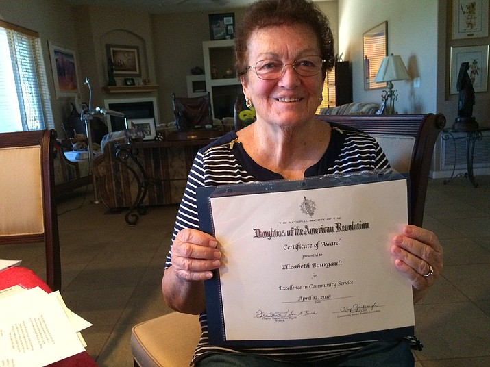 Betty Bourgault shows off her award from the Daughters of the American Revolution. (Nanci Hutson/Courier)