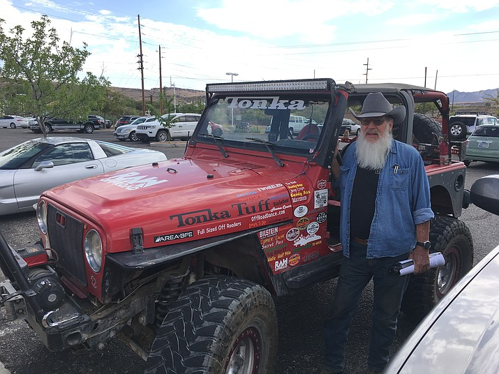 Golden Valley resident Ric Swats, standing by his Tonka Jeep, spoke against the BLM's Travel Management Plan at the Sept. 4 Mohave County Board of Supervisors meeting. The item is on the agenda for Monday's meeting. (Photo by Hubble Ray Smith/Daily Miner)