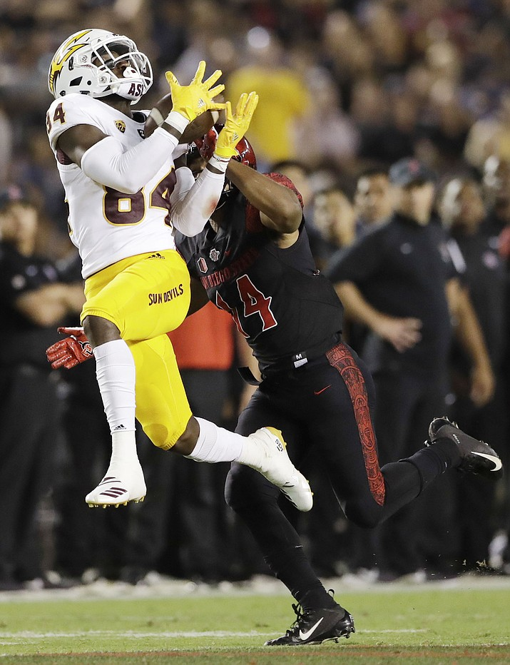 Arizona State wide receiver Tyerell Baldonado-Kaeiopu hauls in a pass as San Diego State safety Tariq Thompson defends during the first half Saturday, Sept. 15, 2018, in San Diego. (AP photo)