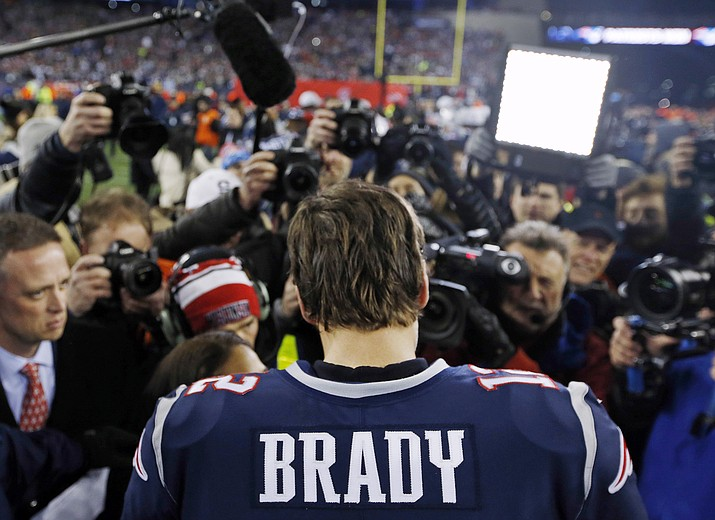 In this Jan. 21, 2018, file photo, New England Patriots quarterback Tom Brady talks with a reporter after the AFC Championship NFL football game against the Jacksonville Jaguars at Gillette Stadium in Foxborough, Mass. If there's ever going to be a changing of the guard in the AFC, then Sunday's visit to Jacksonville by the Patriots would seem a perfect time. Except when you look at the numbers that say Tom Brady doesn't lose to the Jaguars. Ever. (Winslow Townson/AP, File)