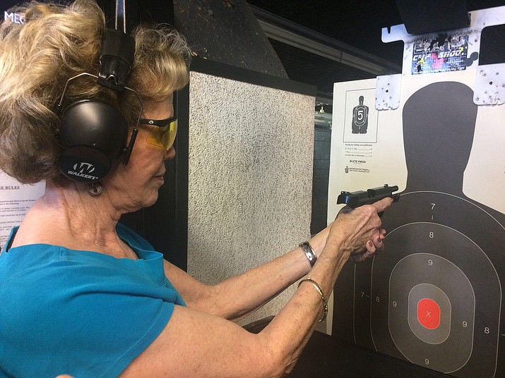 Eileen Sherrill gets some range time in with the type of gun she was looking to buy for self-defense. (Jason Wheeler/Courier)