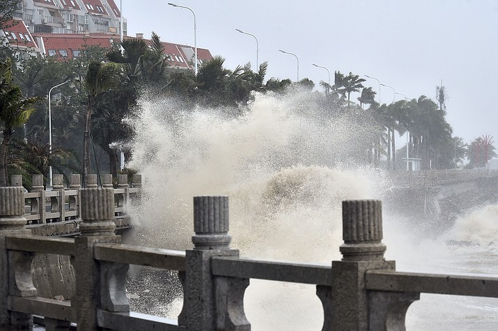 In this photo released by Xinhua News Agency, waves crash onto the coastline in Zhuhai in southern China's Guangdong Province on Sunday, Sept. 16, 2018. Typhoon Mangkhut barrelled into southern China on Sunday after lashing the northern Philippines with strong winds and heavy rain that left at least 64 people dead and dozens more feared buried in a landslide.(Liang Xu/Xinhua via AP)