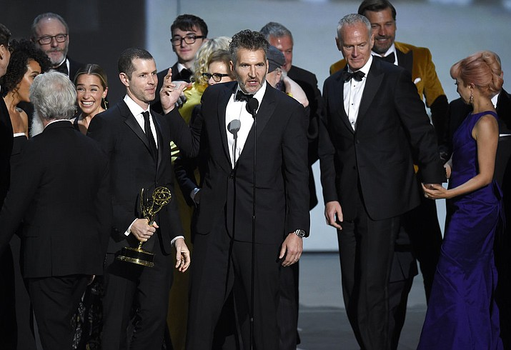 """David Benioff and the cast and crew of """"Game of Thrones"""" accept the award for outstanding drama series at the 70th Primetime Emmy Awards on Monday, Sept. 17, 2018, at the Microsoft Theater in Los Angeles. (Photo by Chris Pizzello/Invision/AP)"""