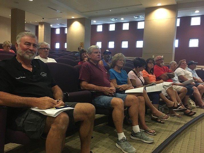 Chuck Brinkley, left, spoke on behalf of about a dozen members of the Golden Shores Off-Roaders who attended Monday's Board of Supervisors meeting. They're unhappy with the BLM's travel management plan to close more than 1,600 miles of trails in the county. (Photo by Hubble Ray Smith/Daily Miner)
