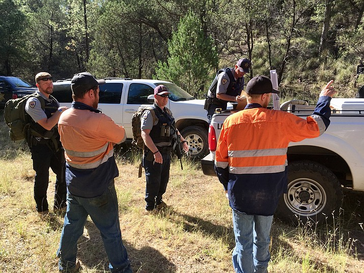 Members of the Arizona Game and Fish Department gear up to look for a black bear after it attacked a man Sunday in Patagonia. (AZGFD/Courtesy, via Twitter)