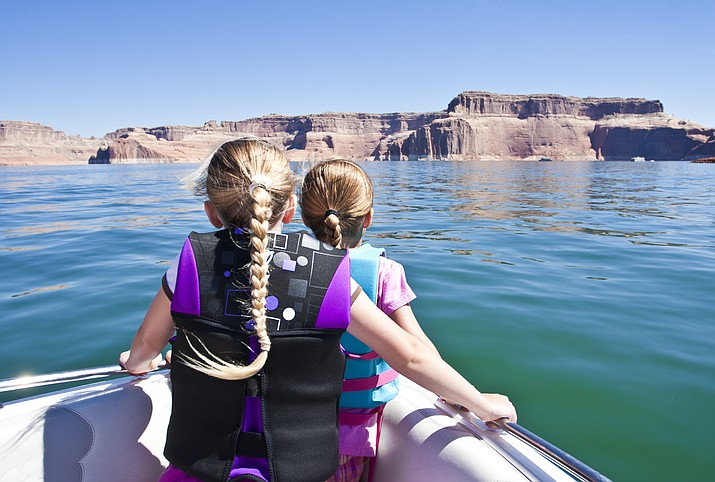 State law requires anyone 12 and under to wear a life jacket at all times when a vessel is underway. (Stock photo)