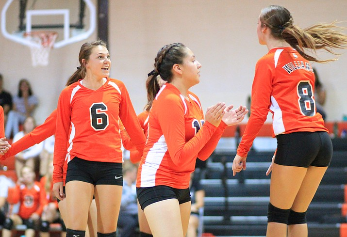 Vikings Maegen Ford, Bridgette Hernandez and Madi Olson celebrate a point during a game with the Mayer Wildcats Sept. 13. (Wendy Howell/WGCN)