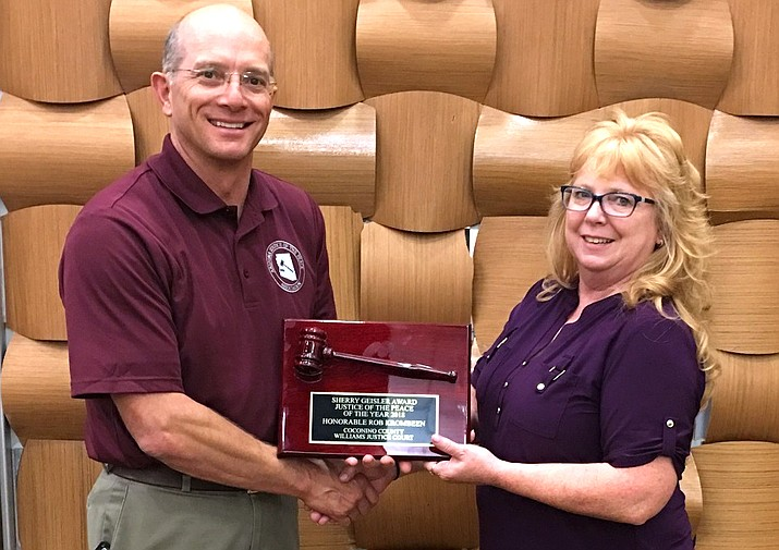 Williams Justice and Municipal Court Judge Rob Krombeen accepts the Arizona Justice of the Peace of the Year award from Judge Dorothy Little Sept. 5. Little is the President of the Arizona Justice of the Peace Association.