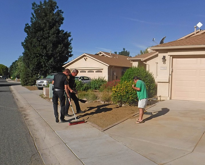 Prescott Valley Police officers help with the cleanup. (PVPD/Courtesy)