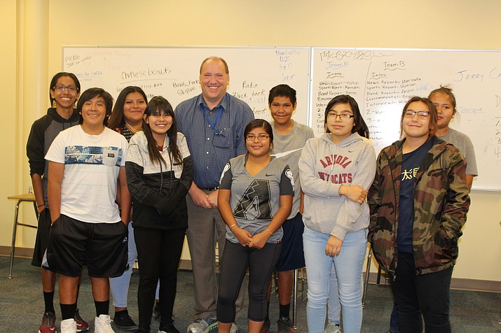 Hopi High Dean of Students Jerry Cronin is surrounded by AVID students (from left) Tyrall Roland, Skylan Masawytewa, Aubrey Harvey, Shaianne Mowa, Mallory Nutumya, Damian Begay, Kira Nevayaktewa, Jacque Thorpe and Dalilah Tsosie. (Stan Bindell/NHO)