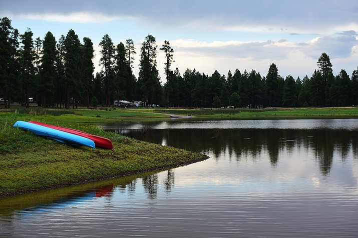 Kayaks rest on the shore of Whitehorse Lake Campground. White Horse Lake located northeast of Williams offers camping, boating, fishing, hiking and more. (Kaibab National Forest)