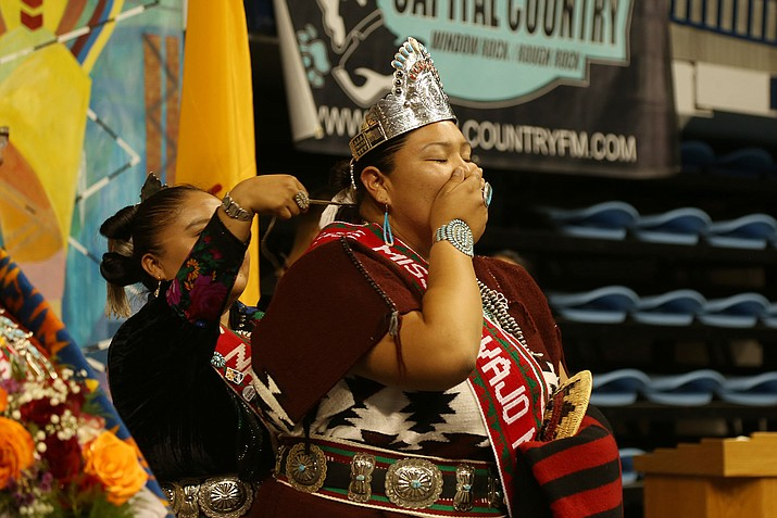 Autumn Montoya is crowned the new Miss Navajo by outgoing royalty Crystal Littleben Sept. 8 at the Fighting Scouts Event Center in Fort Defiance, Arizona. (Navajo Nation Office of the President and Vice President)